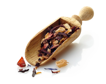 wooden scoop with fruit tea photo