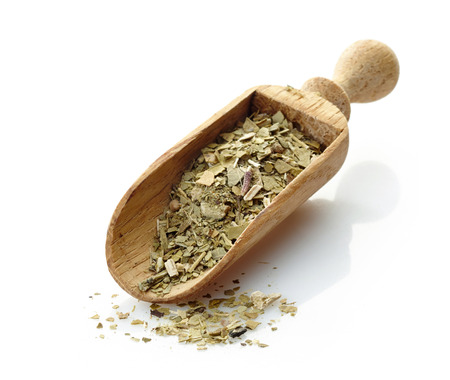 mate drink: wooden scoop with yerba mate tea Stock Photo