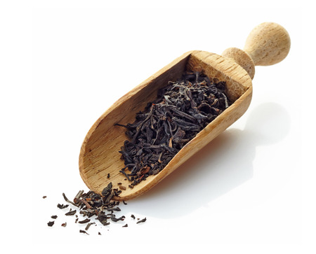 wooden scoop with black tea photo