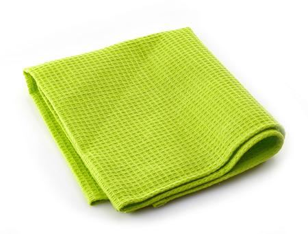 serviette de coton vert sur un fond blanc