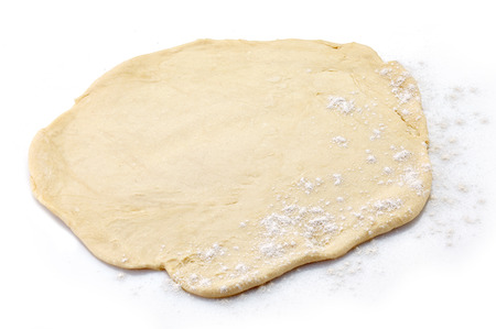 flatten: Fresh dough ready for baking on a white background