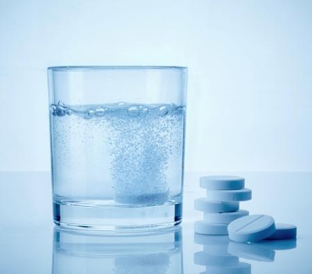 glass of water and aspirin pills