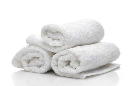 white towels: white spa towels on a white background Stock Photo
