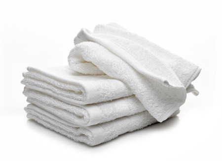 Stack of white hotel towels on a white background Zdjęcie Seryjne