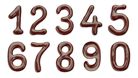 chocolate sauce: Chocolate numbers on a white background Stock Photo