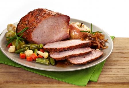 Roast pork on brown plate