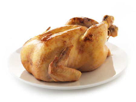 Roasted chicken on white plate photo