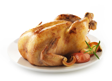 roasted chicken: Roasted chicken and vegetables on white plate