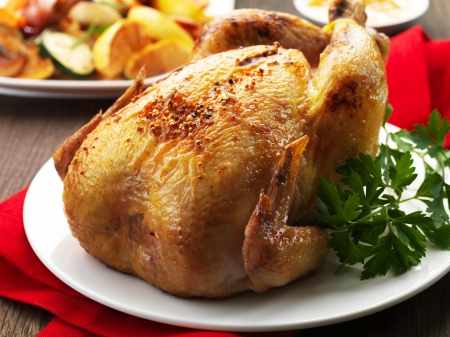 Roast chicken on a white plate Stock Photo