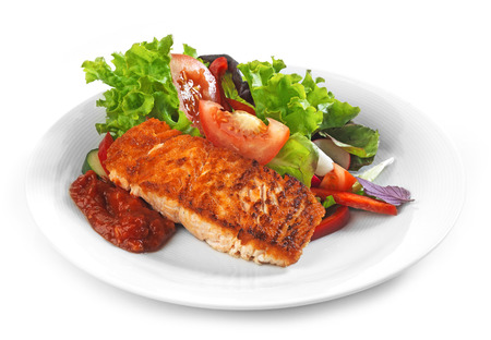 Plate of Grilled salmon fillet and vegetable salad photo