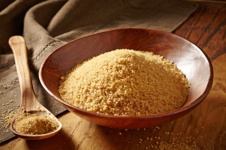 bowl of brown sugar and wooden spoon photo