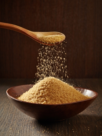 brown sugar: Brown Sugar pouring from a spoon to a bowl