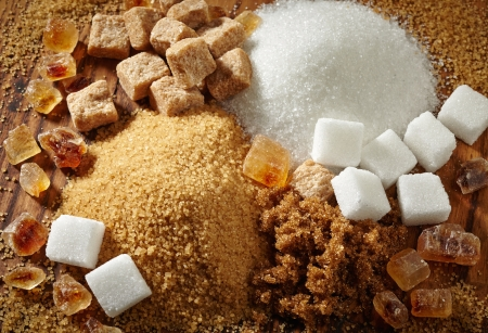 sweetener: various types of sugar on wooden table Stock Photo