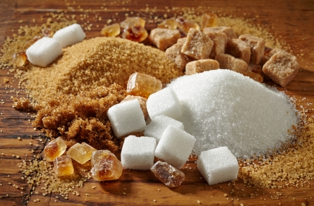granulated: various types of sugar on wooden table Stock Photo