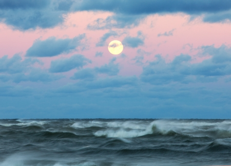 Stormy sea with beautiful moon photo