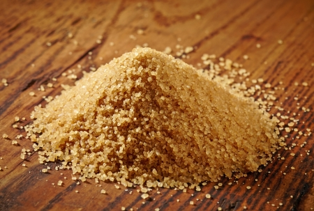 brown sugar heap on wooden table photo