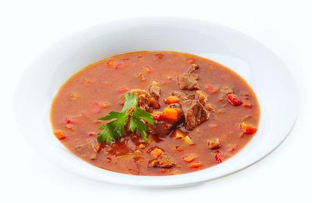 Goulash: goulash soup in white plate Stock Photo