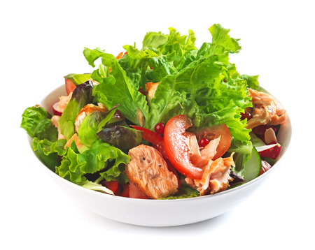 fresh salad with grilled salmon fillet and tomato photo