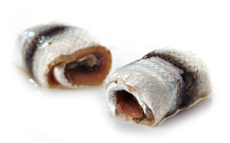 anchovy fish: anchovies rolls on a white  Stock Photo