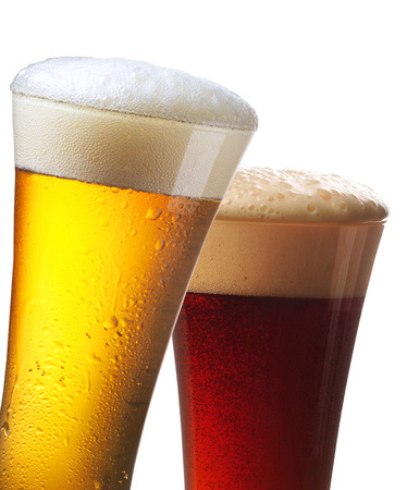 Glasses of light and dark beer on white background photo