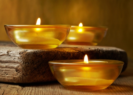 burning candles on wooden table photo