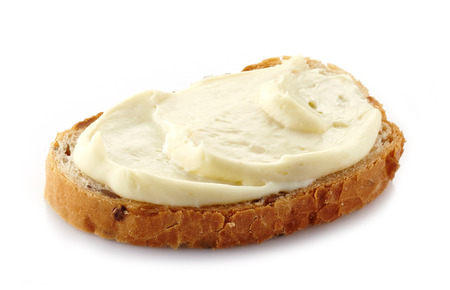 processed: bread with cream cheese on white background