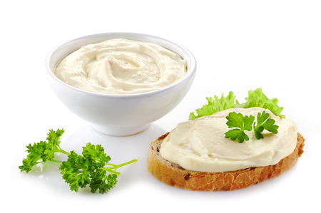 melted cheese: bread with cream cheese on white background