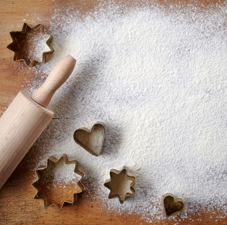 pastry cutters on wooden cutting board photo