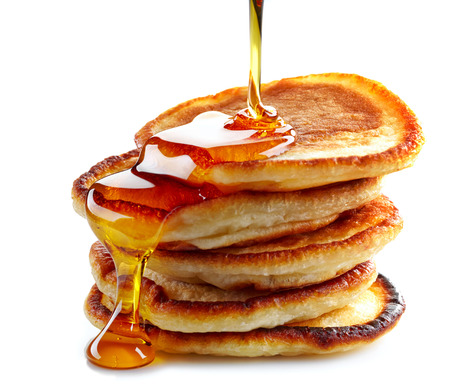 syrup: stack of pancakes on white background