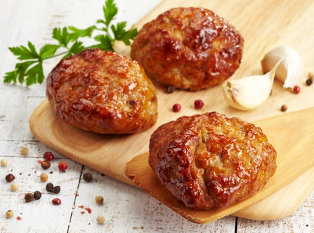 cooked pepper ball: juicy fried meat cutlets on wooden cutting board
