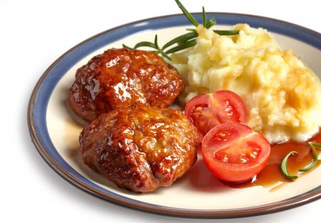 juicy fried meat cutlets on a plate photo