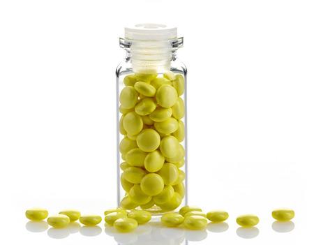 valerian: bottle of yellow medical valerian pills on a white background, herb medicine Stock Photo