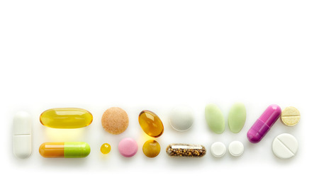 various pills on a white background photo