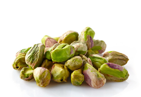 kernels: green pistachios on a white background