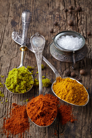 various spices on a dark wooden table photo