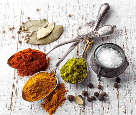 various spices on a white wooden table photo