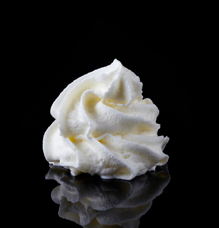 whipped cream on a black background photo