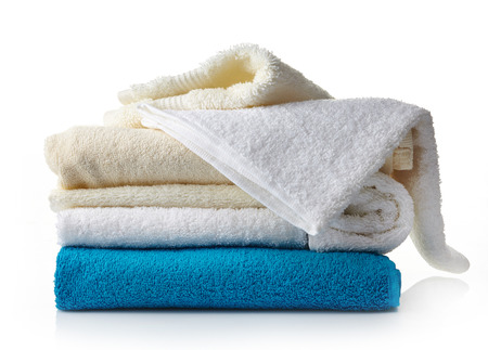 stack of various spa towels on a white background photo