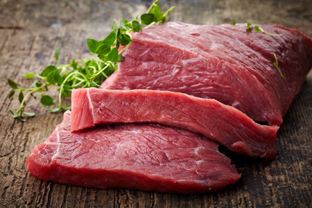 fresh raw meat on old wooden table Stock Photo