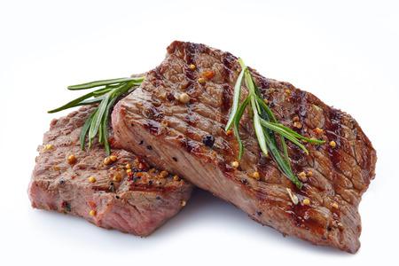 白い背景の上のグリル ステーキ