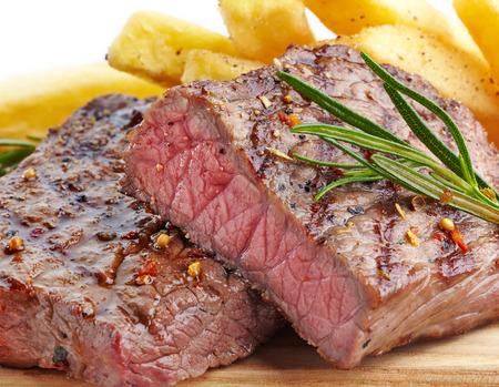 steak beef: grilled beef steak on wooden cutting board