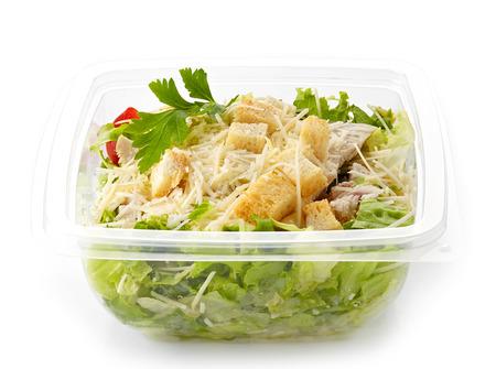 salad dressing: cesar salad in a plastic take away box