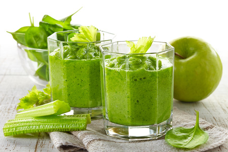 pureed: glass of green smoothie on wooden table Stock Photo