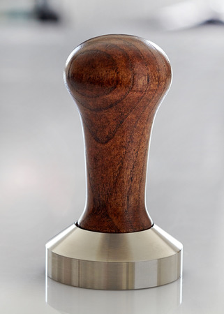 tamper: Ground coffee tamper, baristas equipment Stock Photo