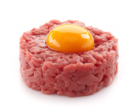 tartar: fresh beef tartare with egg on white background
