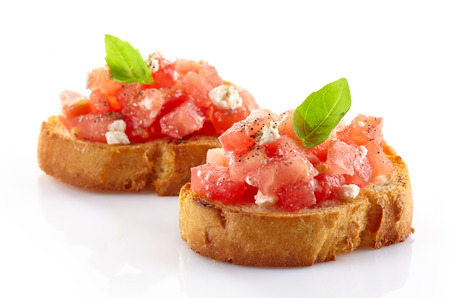 Spanish food tapas  Toast with fresh juicy tomato and basil photo