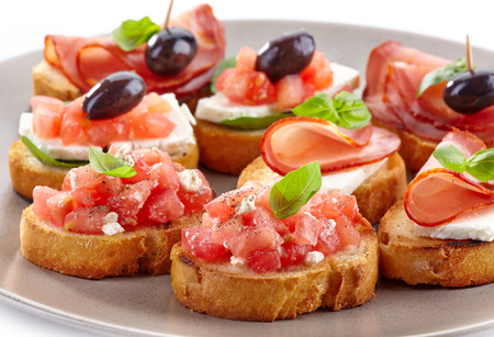Spanish food tapas  Toasted bread with tomato and ham photo