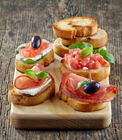 Spanish food tapas  Toasted bread with meat and vegetables Stock Photo - 28424603