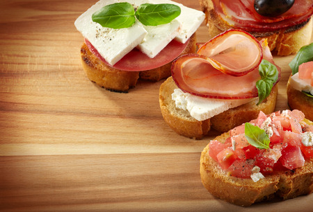 Spanish food tapas  Toasted bread with meat and vegetables photo