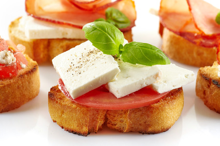Toasted bread with fresh goat cheese and tomato. Spanish tapas Stock Photo - 28512894